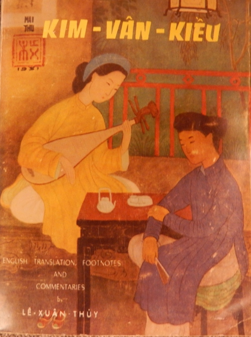 Two girls talking playing traditional instrument